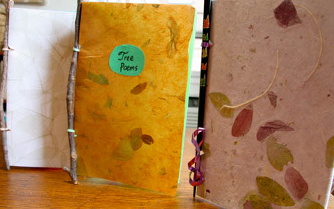 Three handmade stick-and-elastic books